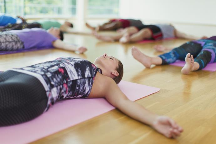 While focusing on your breathing, move your attention through your body, step-by-step. *(Source: Getty)