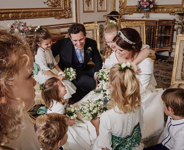 The sweet image shows the bride and groom sharing a moment with their young bridesmaids. *(Image: Instagram / @princesseugenie)*