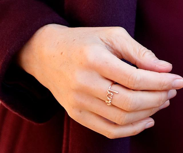 Blink and you'll miss it! The stunning and affordable ring on Meghan's middle finger caught the attention of many. *(Image: Getty)*