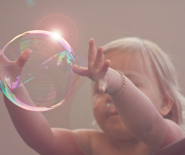 **Bubble:** A fun word to say and learn, you can help your child learn this during bath time, or with a bubble wand or machine. *Image: Getty Images.*
