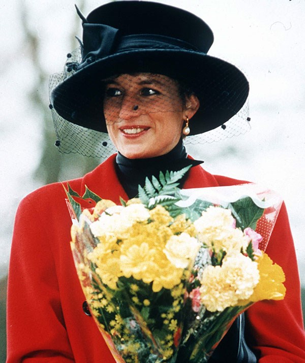 Princess Diana in a broad-brimmed hat with a dramatic veil during Christmas morning at Sandringham in 1993.