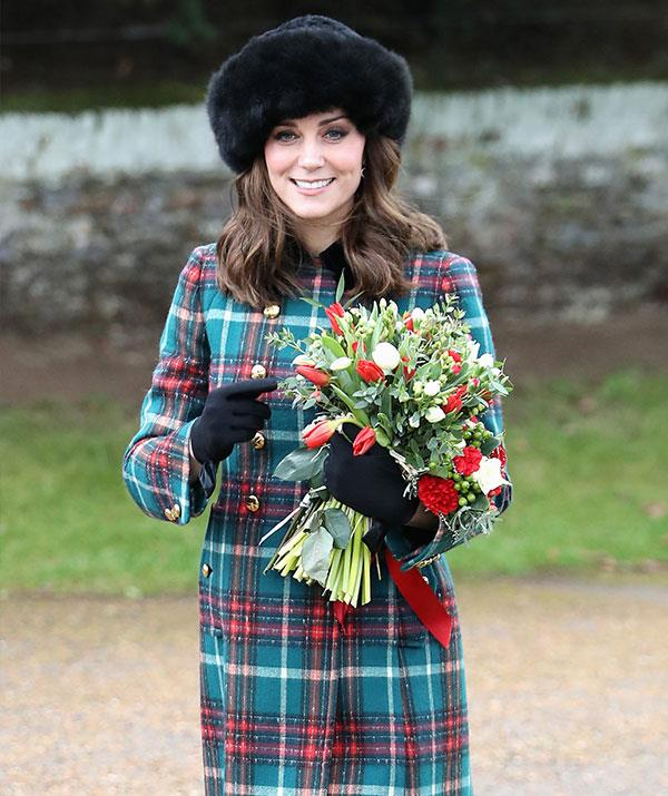 Duchess Catherine's furry black hat and tartan Mui Mui coat kept her cosy during Christmas morning in 2017.