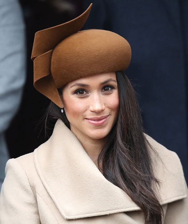 For her first Christmas with the Royal Family in 2017, Meghan opted for a camel-coloured coat by Sentaler and a chestnut-brown felt Philip Treacy hat with an intricate twirl at the top.