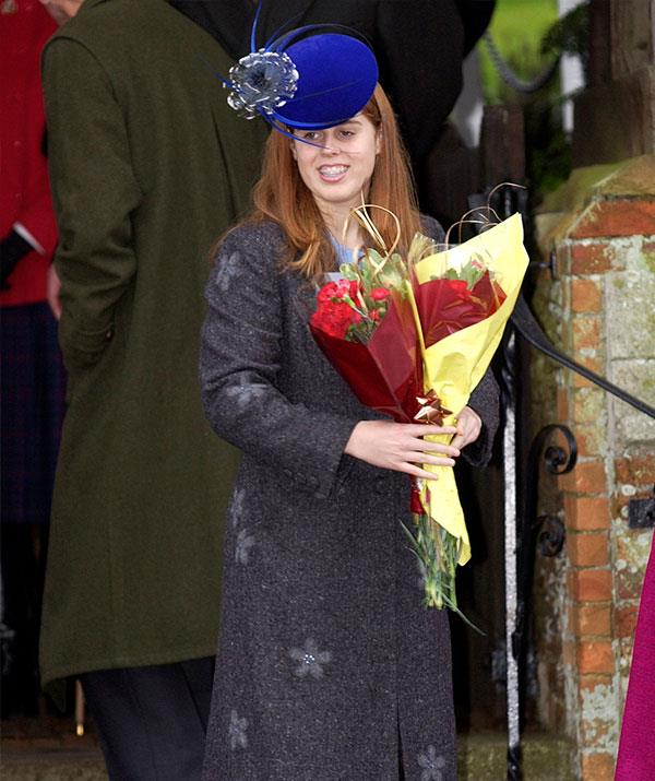 For Christmas in 2002, it was all about the feathered hat and floral jacket for Princess Beatrice.