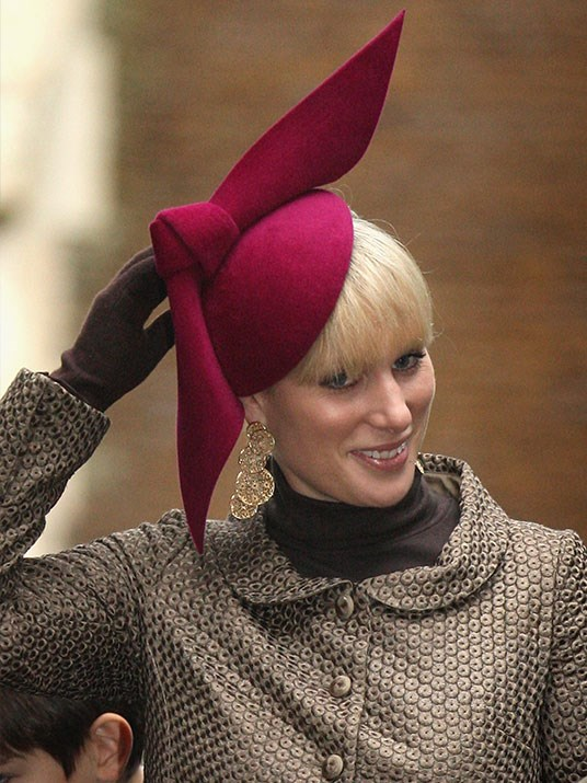 In 2008, Zara was all wrapped up like a present in this red hat with a statement bow.