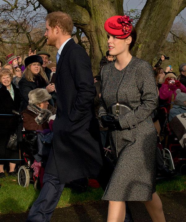Cousins Prince Harry and Princess Eugenie make their way into church together.