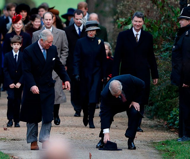 Whoops! Prince Andrew's hat topples off and older brother Prince Charles finds it most amusing.