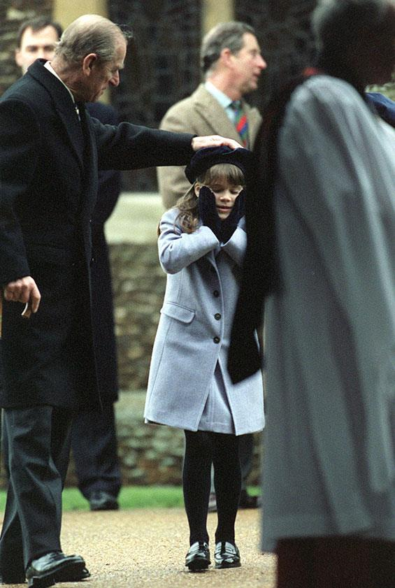Prince Philip shows off his softer side as he lovingly pats granddaughter Princess Eugenie on the head in 1998.