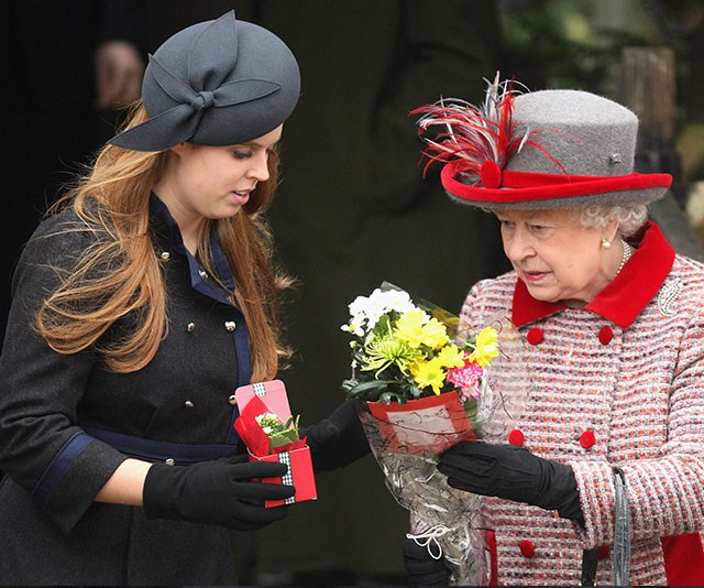 Princess Beatrice helps her grandmother The Queen with a bunch of pretty posies.