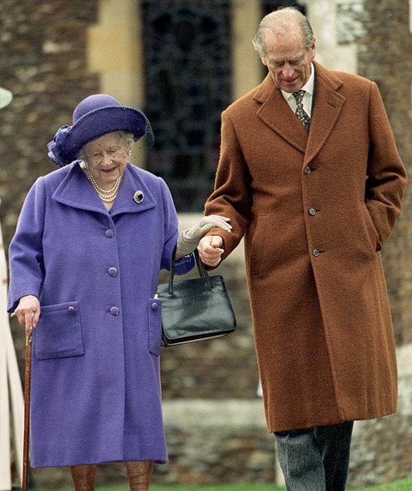 Sweet Prince Philip strikes again as he lends a hand to his mother-in-law, the Queen Mother.