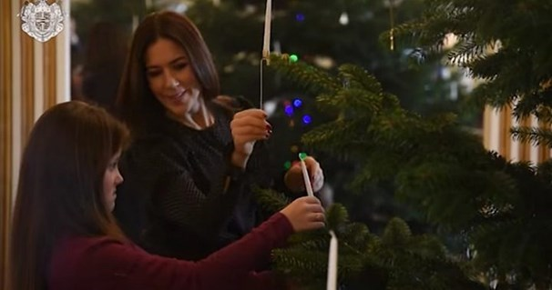 The Danish royals were captured decorating their Christmas tree in a beautiful family video.