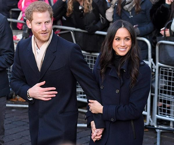 Harry and Meghan aren't afraid to show their affection. *(Image: Getty Images)*