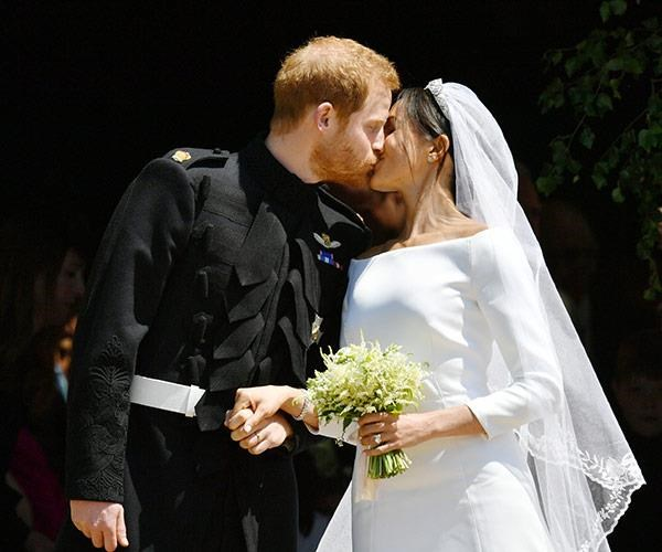 Sealed with a kiss: The newlyweds were watched by billions. *(Image: Getty Images)*