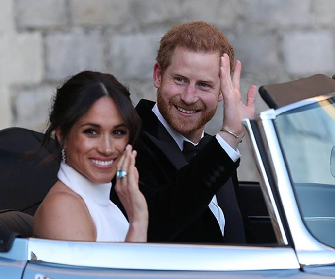 Harry gifted his bride with his mother's aquamarine ring for the evening reception. *(Image: Getty Images)*