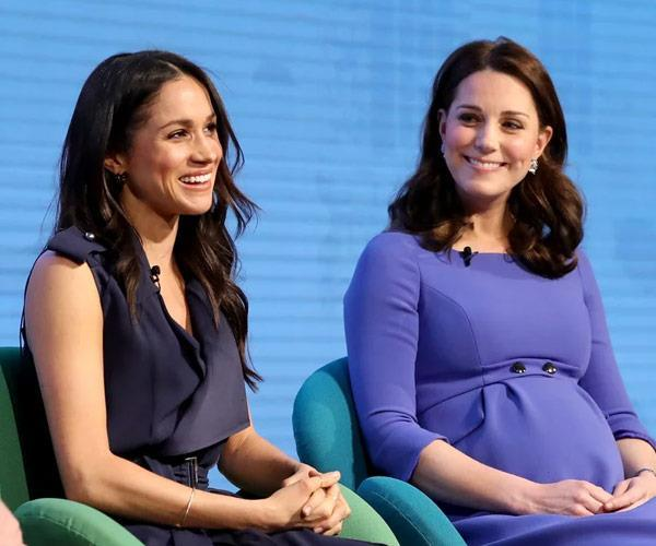 Worlds apart: Sources say Meghan and Kate aren't close and have nothing in common. *(Image: Getty)*