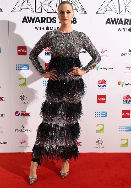 *E!* host Ksenija Lukich is giving us major flapper dancer vibes in this layered black and white frock. *(Image: Getty)*