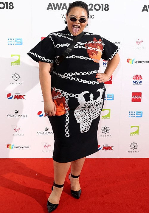 Musician Kira Puru's eye-catching dress is bringing some much needed joy to a grey day. *(Image: Getty)*