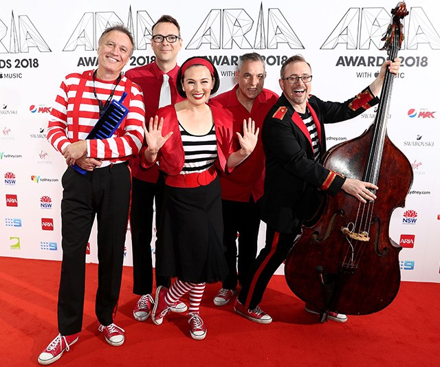 Nope, it's not The Wiggles. Children's band Lah-Lah seem to be embracing a *Where's Wally* theme for today's event. *(Image: Getty)*