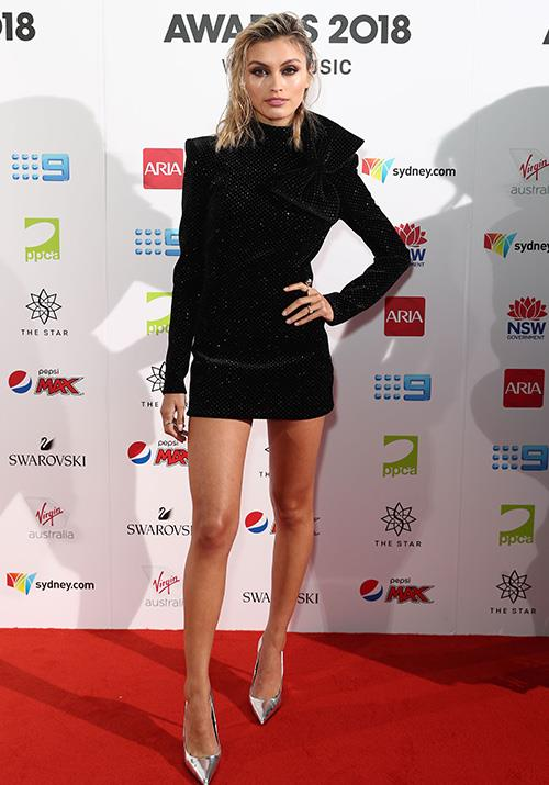 *Neighbours* favourite Sarah Ellen is totally rocking this LDB and wet hair combo. *(Image: Getty)*