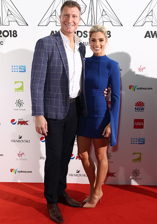 Wiggles power couple Simon Pryce and Lauren Hannaford have arrived and how loved up do they look? *(Image: Getty)*
