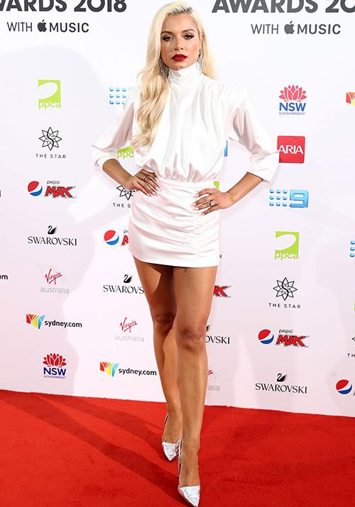 Screw the LBD, DJ Havana Brown opted for a little white dress instead. *(Image: Getty)*