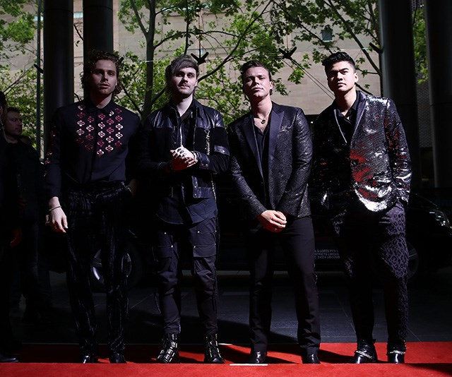 All the boy band vibes! 5 Seconds of Summer's Ashton Irwin, Michael Clifford, Luke Hemmings and Calum Hood are stealing the show.  *(Image: Getty)*