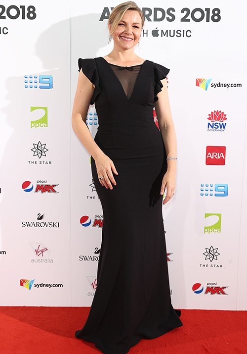 Actress Justine Clarke is all smiles in this strikingly simple black gown. *(Image: Getty)*