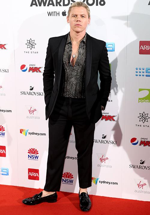 The dapper Conrad Sewell gives us his best blue steel look! *(Image: Getty)*