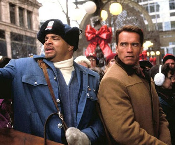 **Jingle All The Way (1996, Netflix)** <br><br> Workaholic Howard Langston (Arnold Schwarzenegger) forgets to buy his son the Turbo-Man doll for Christmas, and he'll go to extreme lengths to make sure he gets his hands on the toy and make things up to his wife Liz (Rita Wilson).