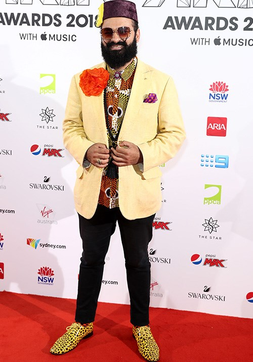 Between the leopard print shoes and the giant orange flower, we don't know which bit of  Joseph Tawadros' outfit to look at first!