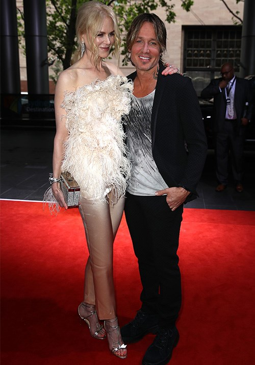 Power couple Nicole Kidman and Keith Urban made their arrival in true head-turning fashion. Host of the night Keith is well and truly embracing smart casual style while Nicole's nude coloured pants made us do a slight double-take! *(Image: Getty)*