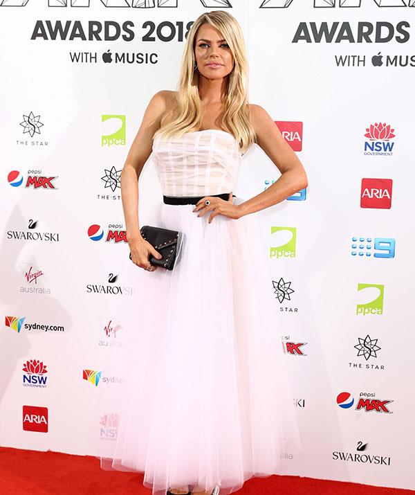 *Love Island* host Sophie Monk's strapless white dress is giving us major bridal vibes! And it comes off the back of the star saying she'd love to marry her new beau Joshua Gross. *(All images: Getty)*