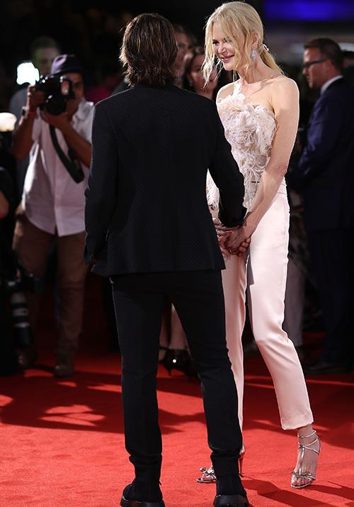 They couldn't help themselves! Nicole smiles as she grabs Keith's hand. *(Image: Getty)*