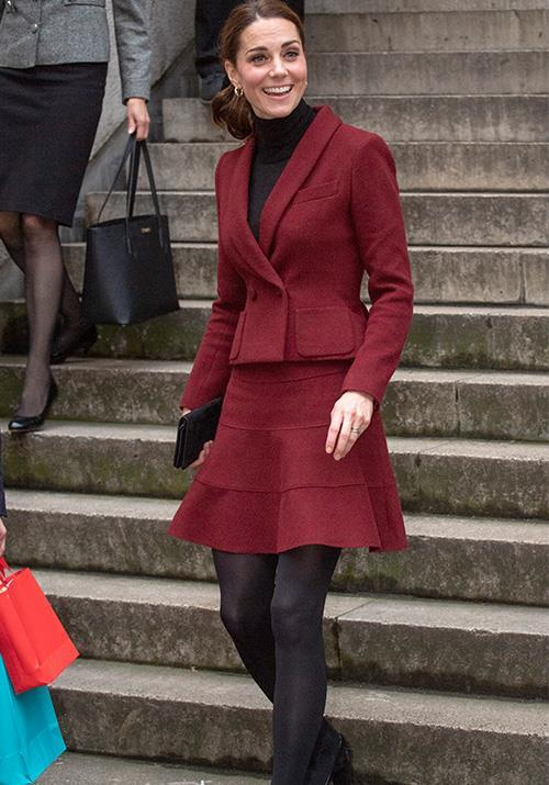 Kate looked stunning in a red skirt and jacket ensemble as she visited University College London. *(Image: Getty)*