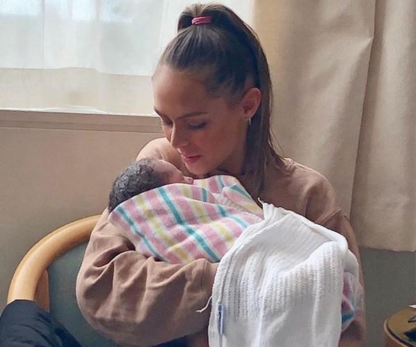 Big sister Mia cradles her baby sister. *(Image: Instagram @mia.fev)*