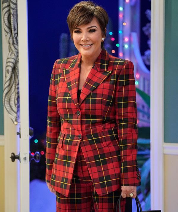 And what's a Christmas special without a cameo from the Queen of Christmas herself, Kris Jenner? The momager, who is great friends with Chrissy and John, is seriously rocking that festive chequered suit. *(Image: Getty)*