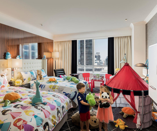"**Swissotel Sydney:** Talk about next level family luxury, the Swissotel offers adjoining kids rooms decked out in age-appropriate toys, DVDs and/or video games. There's also a nanny service should you need it. *Image: [Swissotel Sydney](https://www.swissotel.com/hotels/sydney/ |target=""_blank""