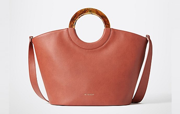 """Is it just us or is this bag totes amazing (sorry, we couldn't resist). With circular tortoiseshell handles and an optional strap, the terracotta-toned tote is pretty and practical. It'll take you from beach to BBQs to school run all summer long. <br><br> [Witchery Calais tote](https://m.witchery.com.au/shop/woman/accessories/bags/60235376/Calais-Tote.html