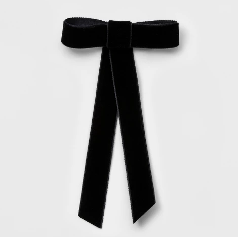 "We could barely spot the different between this $10.00 velvet ribbon and Kate's! Available from [Target](https://www.target.com/p/metal-velvet-ribbon-bow-barrette-wild-fable-153-black/-/A-53514155|target=""_blank""
