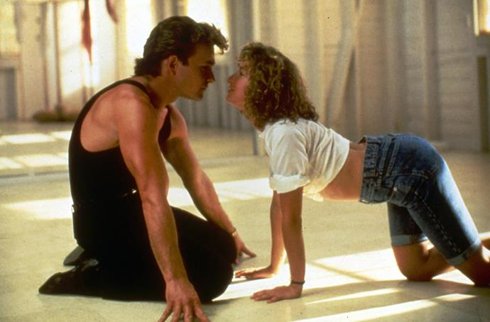 **DIRTY DANCING (1987)** <br><br> While on vacation with her family at a wealthy resort, innocent teenager Baby (Jennifer Grey) finds herself in a secret romance with the resort's dance instructor Johnny (Patrick Swayze).