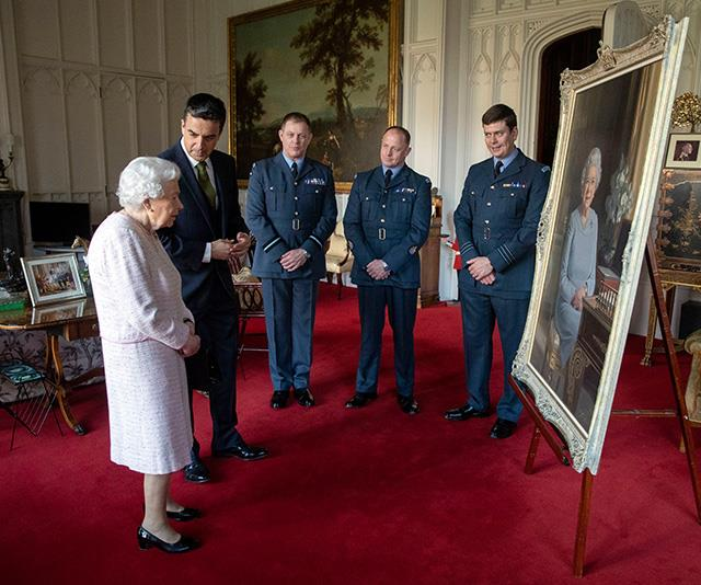 Can you spot it? A new picture of the Queen and her great-grandchildren sits pride of place in this new image. *(Image: AAP)*