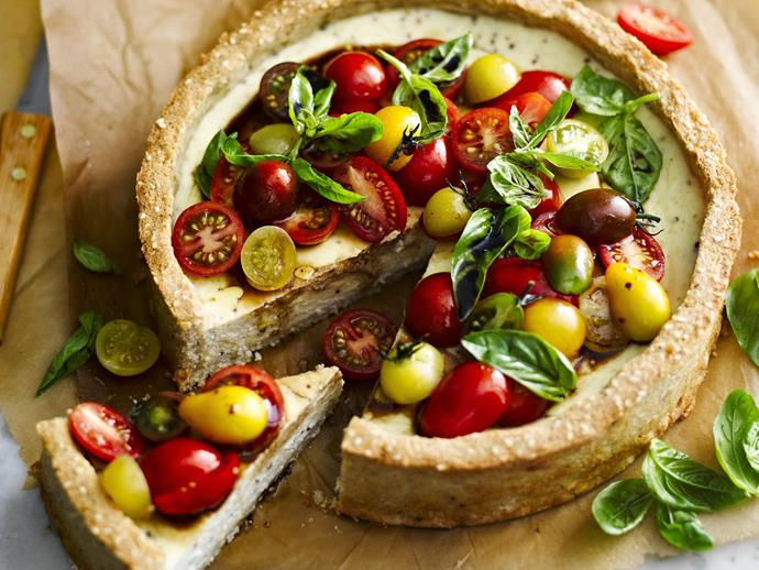 "**Tomato and goat's cheese tart with rice and seed crust** <br><br> This vegetarian tart will act as a coeliac-friendly centrepiece on the dining table. <br><br> [**Read the full recipe here**](https://www.womensweeklyfood.com.au/recipes/tomato-and-goats-cheese-tart-with-rice-and-seed-crust-7995|target=""_blank"")"