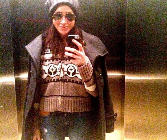 All wrapped up for an elevator selfie.
