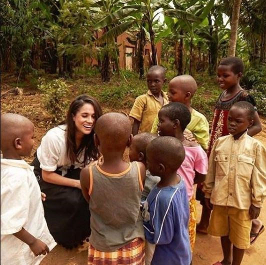 Meghan meeting local children as part of her World Vision trip to Rwanda.