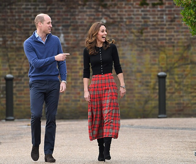 A Merry Christmas indeed! The royal pair were all smiles as they entered the festive event. *(Image: Getty)*