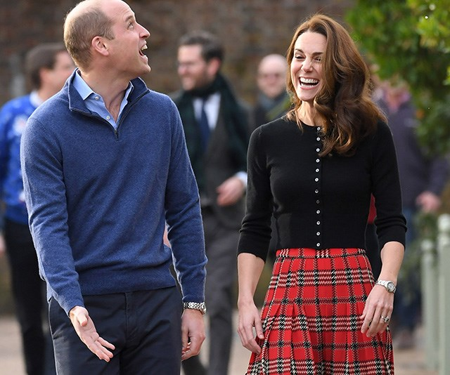 Kate looked stunning in a tartan skirt while Wills opted for a blue jumper and shirt. *(Image: Getty)*