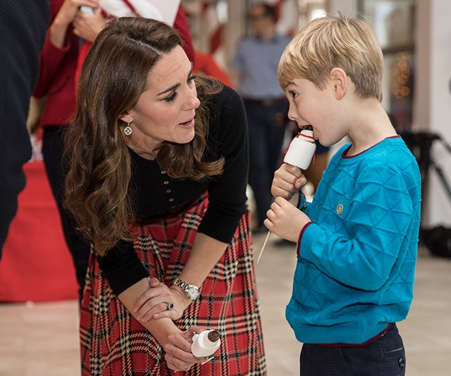Always a natural with kids, Kate had many animated discussions with the young guests at the event. *(Image: Getty)*