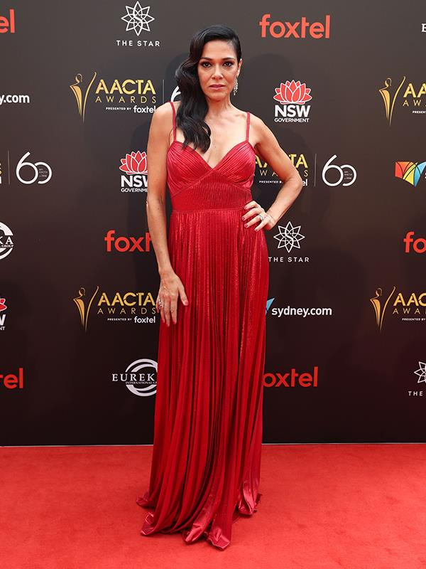New Zealand-born beauty Simone Kessell oozes elegance in this deep-red gown. *(Image: Getty)*