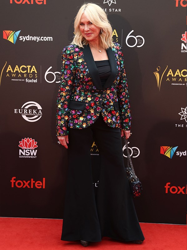 "Queen of the red carpet [Kerri-Anne Kennerley](https://www.nowtolove.com.au/tags/kerri-anne-kennerley|target=""_blank"") has arrived in a fierce pair of flairs and a sequinned floral jacket. *(Image: Getty)*"