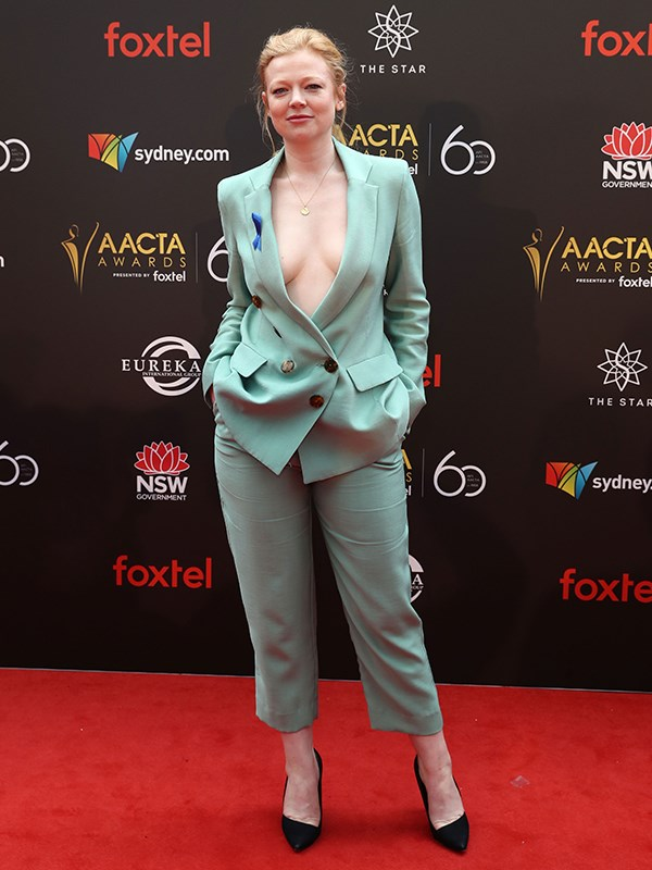 Actress Sarah Snook rocks a plunging mint green suit. *(Image: Getty)*